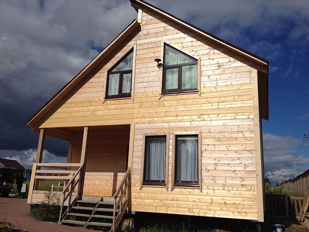 Каркасный дом с отделкой фасада брусом